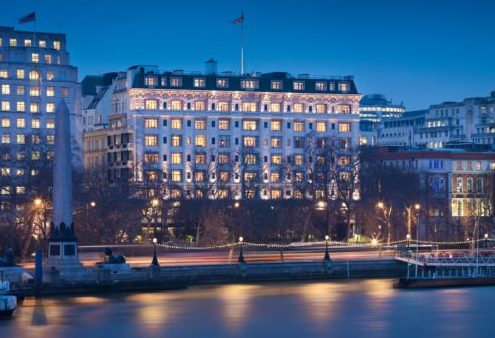 an image of the savoy hotel, on the river thames in London