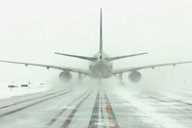 Plane landing in snow
